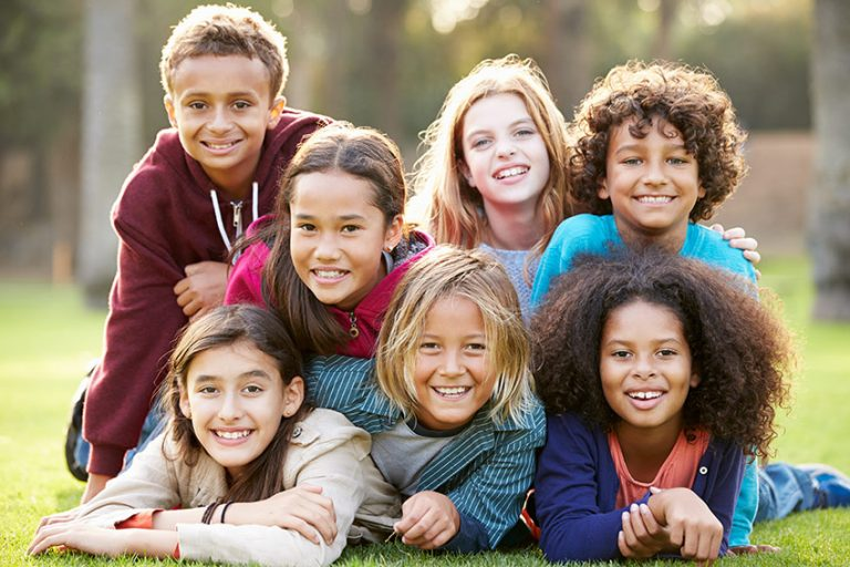 bigstock-Group-Of-Children-Lying-On-Gra-92744366-768x512